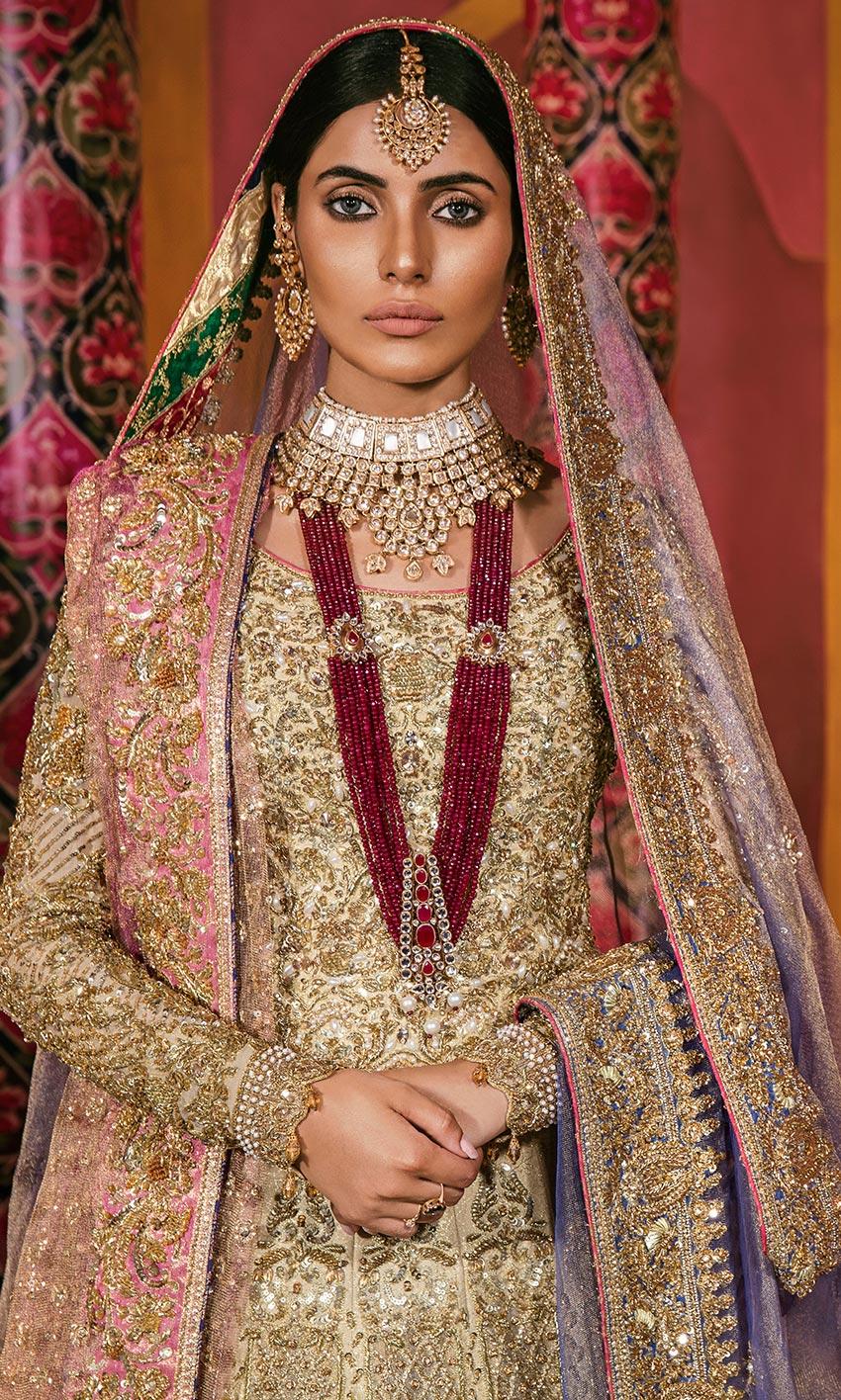 Nomi Ansari Golden Color Lehnda Bridal dress front side 2021