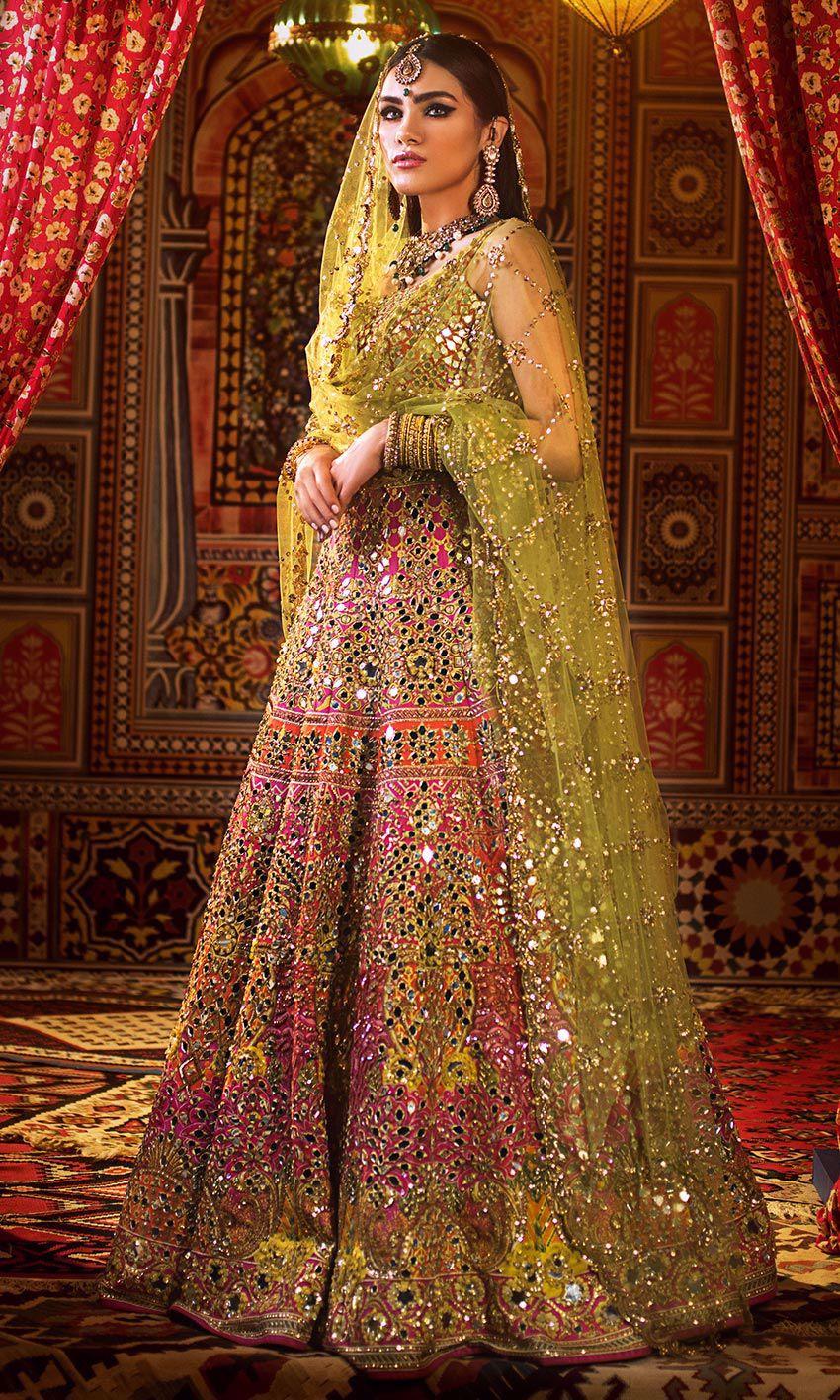 Nomi Ansari yellow & Pink color bridal dress on mehndi day