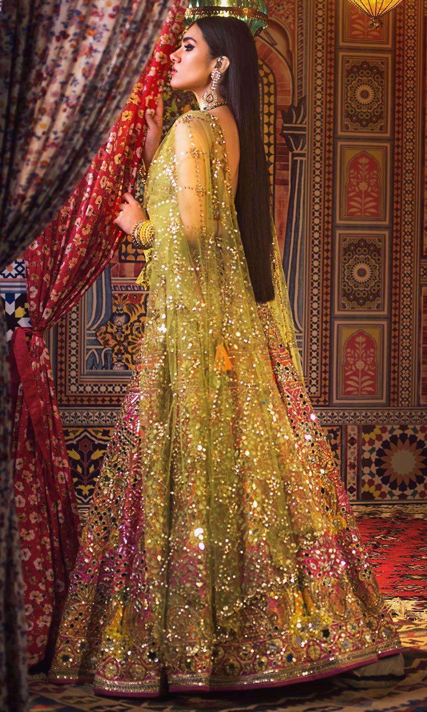 Nomi Ansari yellow & Pink color bridal dress on mehndi day back view
