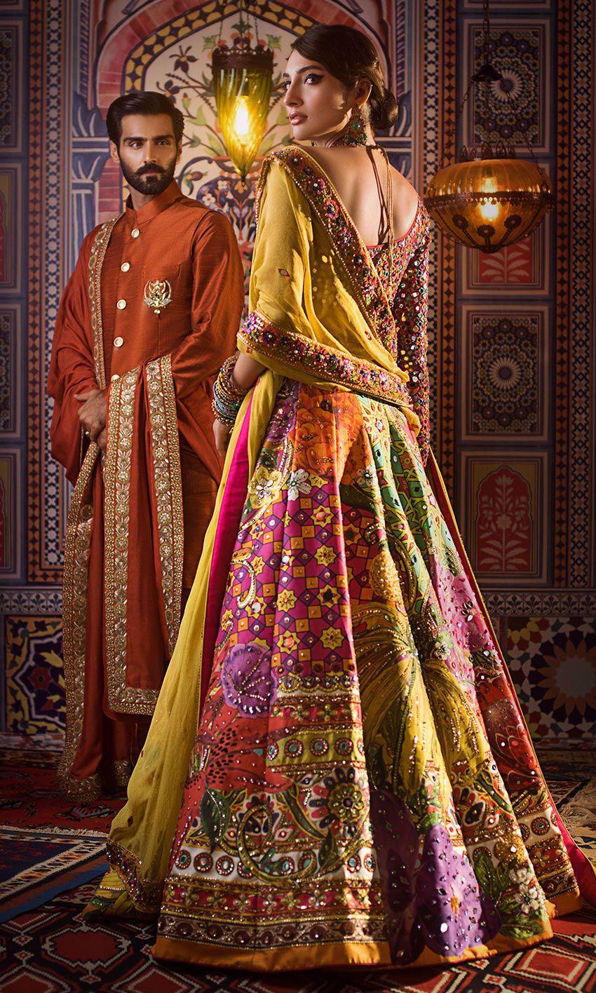 Nomi Ansari Yellow choli & Multi color lehnga bridal dress mehndi day back-side