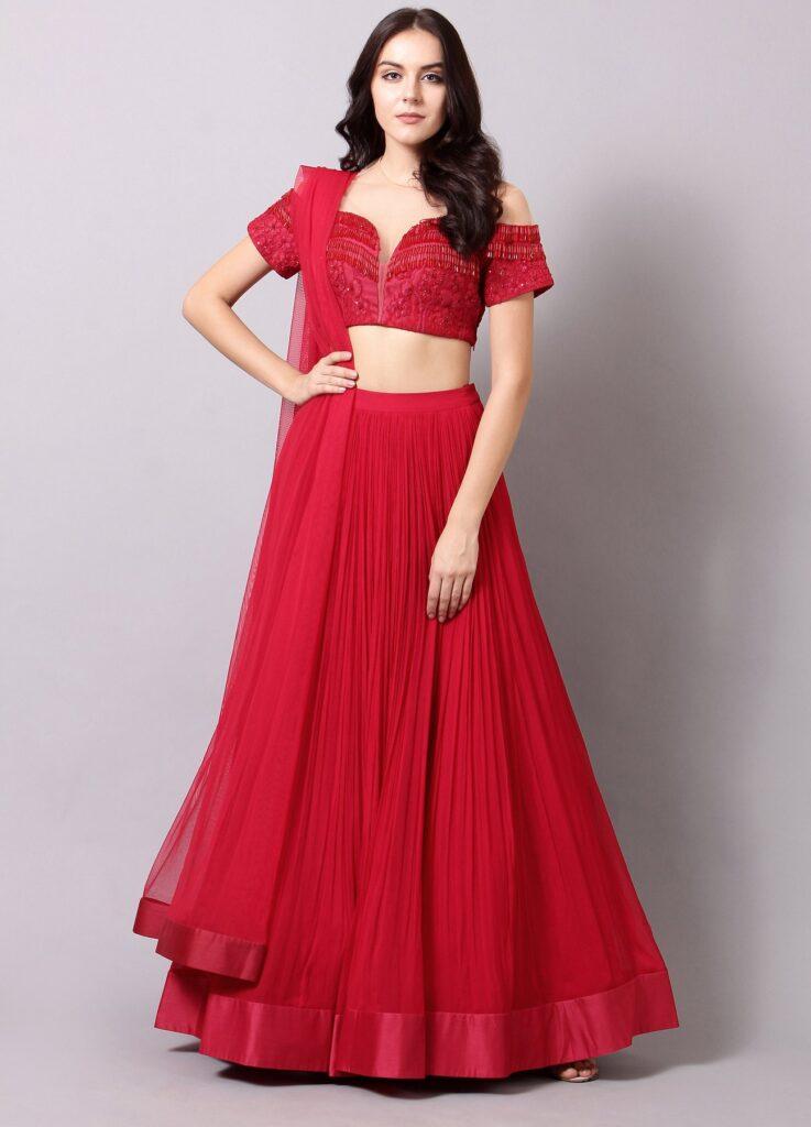 Ridhi Mehra Design lehenga paired with heavily embellished off-shoulder tassel blouse