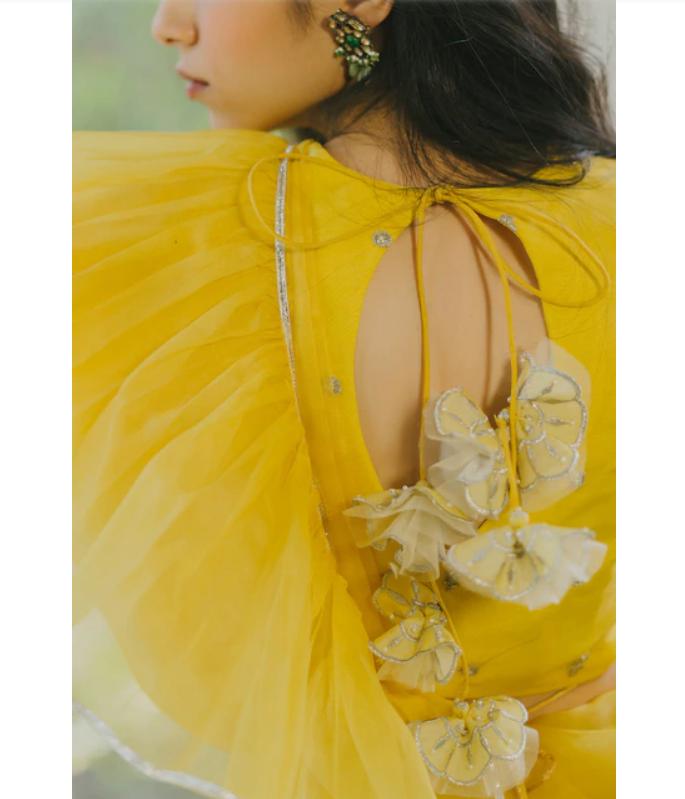 Paulmi And harsh Organza Yellow Saree bac-side